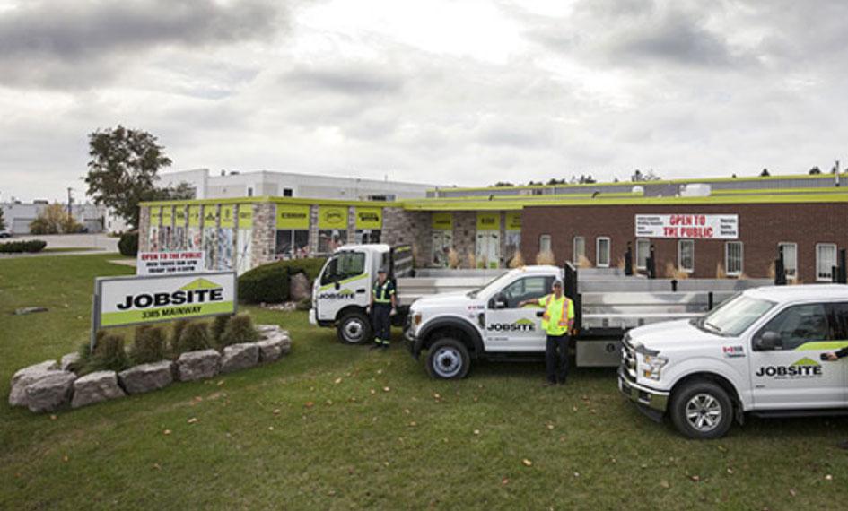 Jobsite office with vans