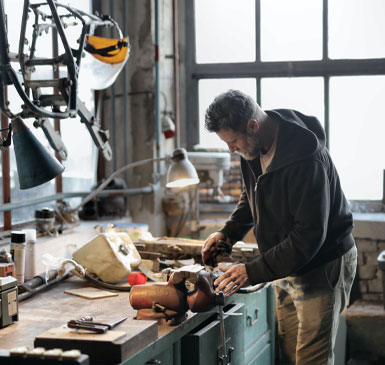 A man working at a work bench
